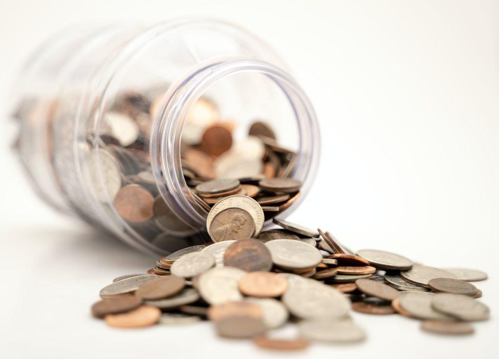 a spilt jar of coins